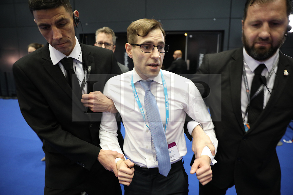 © Licensed to London News Pictures . 04/10/2017. Manchester, UK. Simon Brodkin aka Lee Nelson is kicked out of the conference after handing the Prime Minister a p45. Prime Minister THERESA MAY delivers her keynote speech on the fourth and final day of the Conservative Party Conference at the Manchester Central Convention Centre . Photo credit: Joel Goodman/LNP