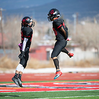 Grants Pirates Travis Barnhill (12), left, and running back Isaiah Johnson (20) celebrate Johnson's touchdown run Saturday afternoon in the 2019 4A NMAA State Football Championship quarterfinal game against Kirtland Central at Grants High School in Grants. Grants beat Kirtland 56-13.