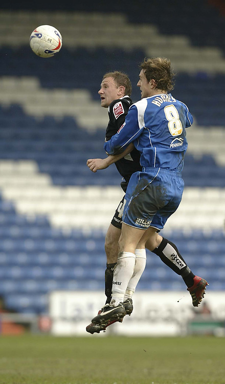 Photo: Aidan Ellis.<br /> Oldham Athletic v Swansea City. Coca Cola League 1. 22/04/2006.<br /> Swansea's Kristian O'Leary battles with Oldham's Mark Hughes