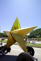 Stock photo of a giant yellow star shaped car