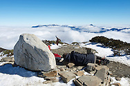 Nap time at Snow Mountain Main Peak.  On long, grueling hikes like this one, its amazing how tired your body and mind can become.  Still, the beauty of such places is amazing, and the peaks of mountains not yet climbed teased us by peaking through the clouds.