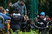 National Eviction Team enforcement agents grapple with activists from HS2 Rebellion seeking to prevent or delay tree cutting in conjunction with the HS2 high-speed rail link in Denham Country Park on 7 September 2020 in Denham, United Kingdom. Anti-HS2 activists continue to campaign and take direct action against the controversial £106bn project for which the construction phase was announced on 4th September from a series of protection camps based along the route of the line between London and Birmingham.