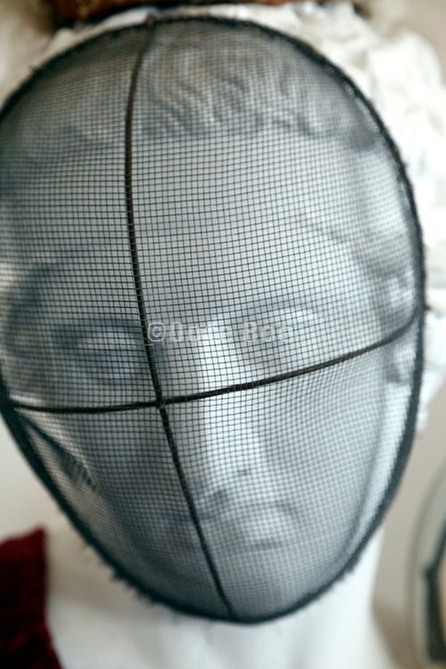 white classic looking plaster head with an old style fencing foil protective mask inside the Salvador Dali Museum Portlllgat Spain