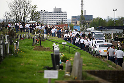 © Licensed to London News Pictures. 21/04/2018. London, UK. The coffin being carried at the burial of traveller 'Queenie, Elizabeth Doherty at Kensal Green Cemetery in west London, following a funeral service in Cobham, Surrey. Elizabeth Doherty, whose son Paddy Doherty is known for appearing on My Big Fat Gypsy Wedding and winning Celebrity Big Brother 8, died of a heart attack earlier this month. Paddy Doherty claimed his mother has died of a 'broken heart' following the death of her husband almost a year ago. Photo credit: Ben Cawthra/LNP