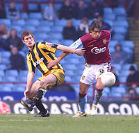 Photo: Dave Linney.<br />Aston Villa v Port Vale. The FA Cup. 28/01/2006Aston Villa's .Milan Baros(R) holds off the challenge from   Tony Dinning