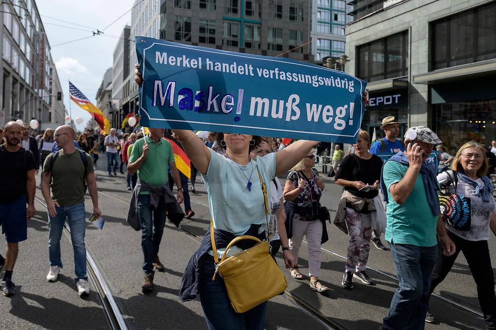 """29 AUG 2020, BERLIN/GERMANY:<br /> Demonstrantion mit Transparent """"Merkel muß weg"""" geaendert in """"Maske muss weg"""", Demonstration gegen die Einschraenkungen in der Corona-Pandemie durch die Initiative """"Querdenken 711"""" aus Stuttgart unter dem Motto """"invites Europa - Fest für Freiheit und Frieden"""", Friedrichstrasse<br /> IMAGE: 20200829-01-010<br /> KEYWORDS: Demo, Protest, Demosntranten, Protester, COVID-19, Corona-Demo"""