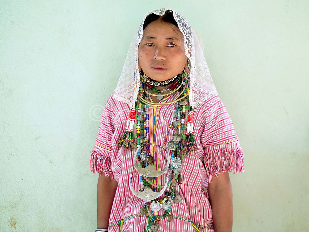 Portrait of an ethnic Kayah woman at the Easter Sunday service at St Michaelss church in village of Yo Co Pra on 27th March 2016 in Kayah State, Myanmar. In the past most people residing in Kayah State were traditional spirit worshippers, but significant numbers have converted to Christianity, especially  Baptists or Catholics