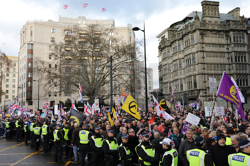 © Licensed to London News Pictures. 09/12/2018. London, UK. Pro-Brexit protesters join the 'Brexit Betrayal' march in central London, led by far-right activist Tommy Robinson. Prime Minister Theresa May's proposed Brexit deal will be voted on by MPs in the coming week. Photo credit: Rob Pinney/LNP