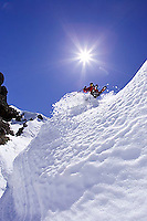 Young man dropping into couloir at Kirkwood ski resort near Lake Tahoe, CA.<br />