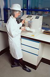 Female scientist working in food laboratory; testing food sample,