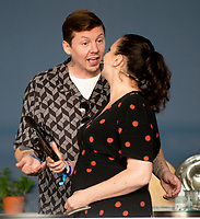 Gizzi Erskine teaching Professor Green  how to make a homemade Doner Kebab at the Big Feastival 2021 on Alex James' Cotswolds farm, Kingham oxfordshire