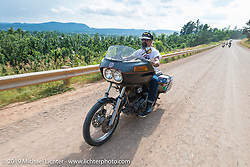 American Motordrome Wall of Death rider Charlie Ransom takes the back roads north of Sturgis to the Broken Spoke County Line during the Sturgis Black Hills Motorcycle Rally. SD, USA. August 4, 2014.  Photography ©2014 Michael Lichter.