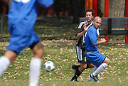 Deportivo Colomex Offensive Lineman Eduardo Jimenez (#11) competes for control of the ball against Team Shlama F.C. during National Soccer League play in Skokie, Il.