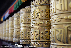Prayer wheels at Swayambhunath, also known as the Monkey Temple, in the Kathmandu Valley. This complex that dates back to the 5th century its revered by both Buddhists and Hindus and includes a large stupa as well as a group of shrines and temples that we visited during our Himalayan Heroes adventure, Nepal. Monday, November 5, 2018. Photography ©2018 Michael Lichter.