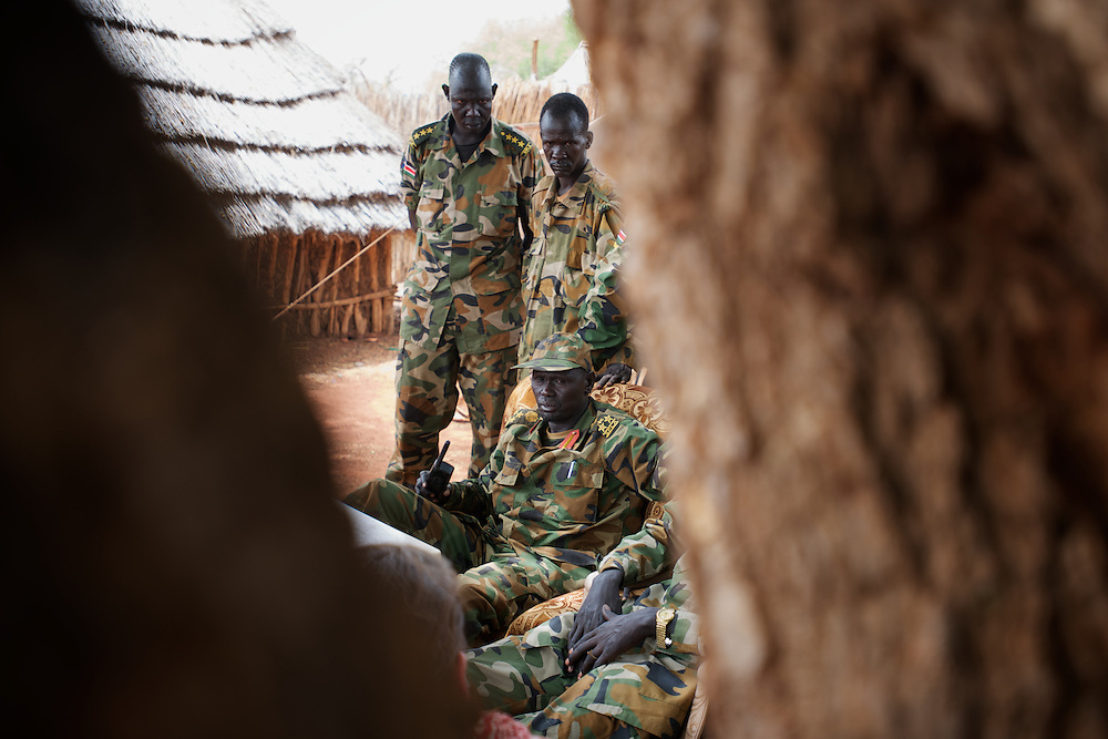 April 24, 2012 - Lalop, South Sudan: SPLA field commander, Daniel Marin, talks to the press at the newly established military base in the village o Lalop, 50 kilometers north of Bentiu...South Sudan and their northern neighbors, Sudan, have in the past two weeks been involved in heavily clashes over border disputes. Bentiu and neighboring villages have been under constant bombardment by the troops os Karthoum , who established their positions around 10 kilometers into South Sudan's territory. The international community is concerned about the possibility of a full on war between the two countries. (Paulo Nunes dos Santos/Polaris)