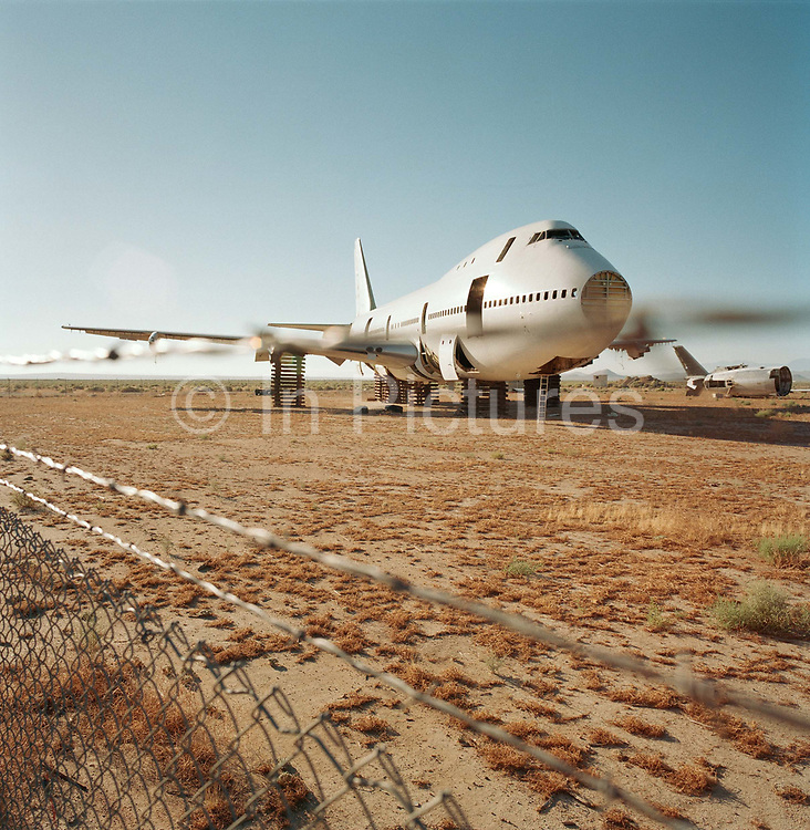 In mid-day heat of the arid Sonoran desert sit the remains of a Boeing 747 airliner at the storage facility at Mojave, California. Here, the fate of the world's retired civil airliners is decided by age or a cooling economy and are either cannibalised for still-working parts or recycled for scrap, their aluminium fuselages worth more than their sum total. After a lifetime of safe commercial flight, wings are clipped and cockpits sliced apart by huge guillotines, cutting through their once-magnificant engineering. Picture from the 'Plane Pictures' project, a celebration of aviation aesthetics and flying culture, 100 years after the Wright brothers first 12 seconds/120 feet powered flight at Kitty Hawk,1903.
