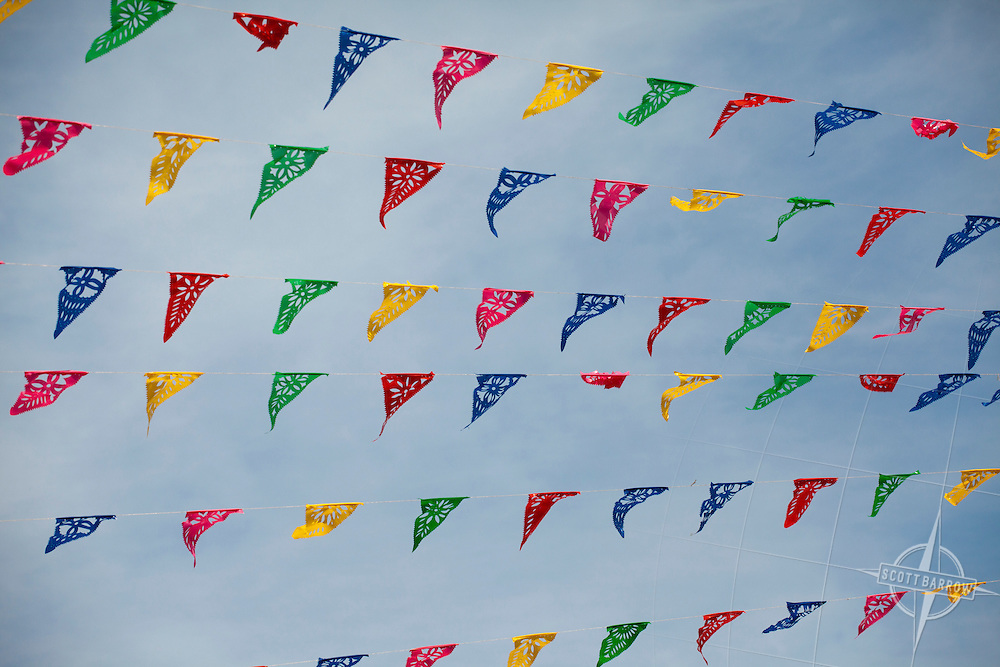 Attention grabbing, colorful flags blowing in the wind to announce an event or location.