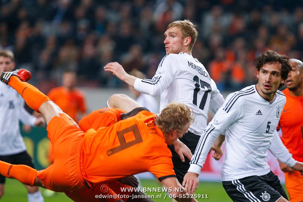 NLD/Amsterdam/20121114 - Vriendschappelijk duel Nederland - Duitsland, dirk kuyt, Per Mertesacker, Mats Hummels