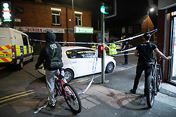 © Licensed to London News Pictures. 26/07/2020. Manchester, UK. Police tape seals off Henbury Street. A 17 year old boy has been stabbed to death and three others stabbed causing injuries , in the Moss Side area of South Manchester this evening. Photo credit: Joel Goodman/LNP