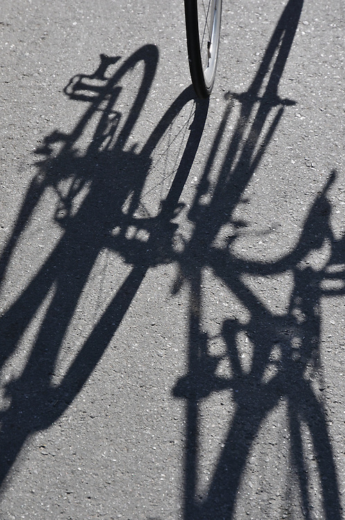 Wheels and bikes cast shadows at the Spring 2013 Bicycle Swap Meet. Bike-tography by Martha Retallick.