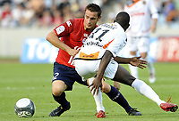 Fotball<br /> Frankrike<br /> Foto: DPPI/Digitalsport<br /> NORWAY ONLY<br /> <br /> FOOTBALL - FRENCH CHAMPIONSHIP 2009/2010 - L1 - LILLE OSC v FC LORIENT - 9/08/2009<br /> <br /> YOHAN CABAYE (LIL) / SIGAMARY DIARRA (LOR)