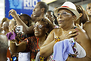 Adoring fans of Salgueiro Samba School sing along to their song, as the school from the Special Group practice their Carnival procession in the Sambadrome, Rio de Janeiro, Brazil