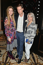 Left to right, KATIE READMAN, PERCY PARKER and PIPS TAYLOR at a dinner hosted by Amy Molyneaux and Percy Parker of fashion label PPQ to celebrate the PPQ AW 2015 collection 'Persephone' held at Braserie Chavot, 41 Conduit Street, London on 22nd February 2015.