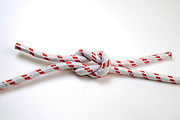 The Reef (Square) Knot on white background a Binder Knot It is easy tied and will not jam, so it is always easy to untie