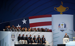 Team USA captain Jim Furyk makes a speech with Team USA and their wives and girlfriends behind during the Ryder Cup Opening Ceremony at Le Golf National, Saint-Quentin-en-Yvelines, Paris.