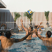 young Indian guys enjoy a ball game at the Aqua pool club of the Park Hotel in New Delhi