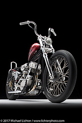 """""""Supafly"""", a red with black and silver flames panhead built by Chris Wade of Fort Mill, SC. Photographed by Michael Lichter during the Easyriders Bike Show in Columbus, OH on February 10, 2017. ©2017 Michael Lichter."""