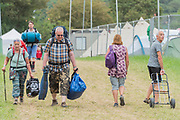Sunday morning and people begin to head off or to load their cars for a quick getaway later - The 2019 Glastonbury Festival, Worthy Farm. Glastonbury.
