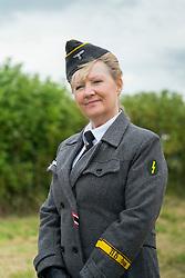 Reenacting Wehrmachthelferin, a Heer Nachrichtenhelferin or Blitzmadel<br /> German female signals auxiliary <br />  17 July 2016<br />  Copyright Paul David Drabble<br />  www.pauldaviddrabble.photoshelter.com