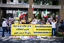 May 19, 2017 - Washington, DC, U.S - Presidential elections were held in Iran on 19 May 2017. It was the twelfth presidential election in Iran. Local elections was also held alongside this election. Most of the Iranian who living in Metropolitan area was voting in the three branch around MD, DC, VA. Iran has Interests Section in Washington DC..The photograph shows that some protester to Iran regime form MEK opposite of the interests section islamic republic of Iran. (Credit Image: © Ardavan Roozbeh via ZUMA Wire)