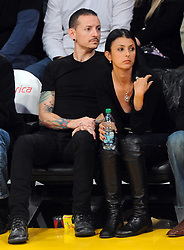 ©2011 GAMEPIKS 310-828-3445<br /> <br /> Linkin Park lead singer Chester Bennington and his wife Talinda Bentley sits courtside as he attends the Los Angeles Lakers/Portland Trail Blazers NBA game at Staples Center in Los Angeles on March 20, 2011. The Lakers defeated the Blazers 84-80.<br /> <br /> XYZ (Mega Agency TagID: MEGAR32159_7.jpg) [Photo via Mega Agency]