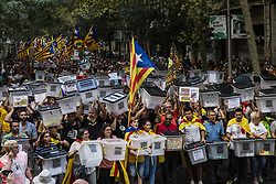 October 1, 2018 - Girona - Pro Catalan independence people carrying ballot boxes during a demonstration to commemorate the first anniversary of the Independence referendum in 1st of October, on 01 of October of 2018, Spain. (Credit Image: © Xavier Bonilla/NurPhoto/ZUMA Press)