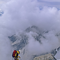 MOUNTAINEERING, Kris Erickson (MR) climbs Owen-Spaulding route near summit of Grand Teton, Wyoming.