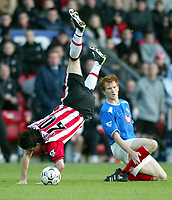 Photograph: Scott Heavey.<br />Southampton v Portsmouth. FA Barclaycard Premiership. 21/12/2003.<br />Hayden Foxe sends David Prutton flying