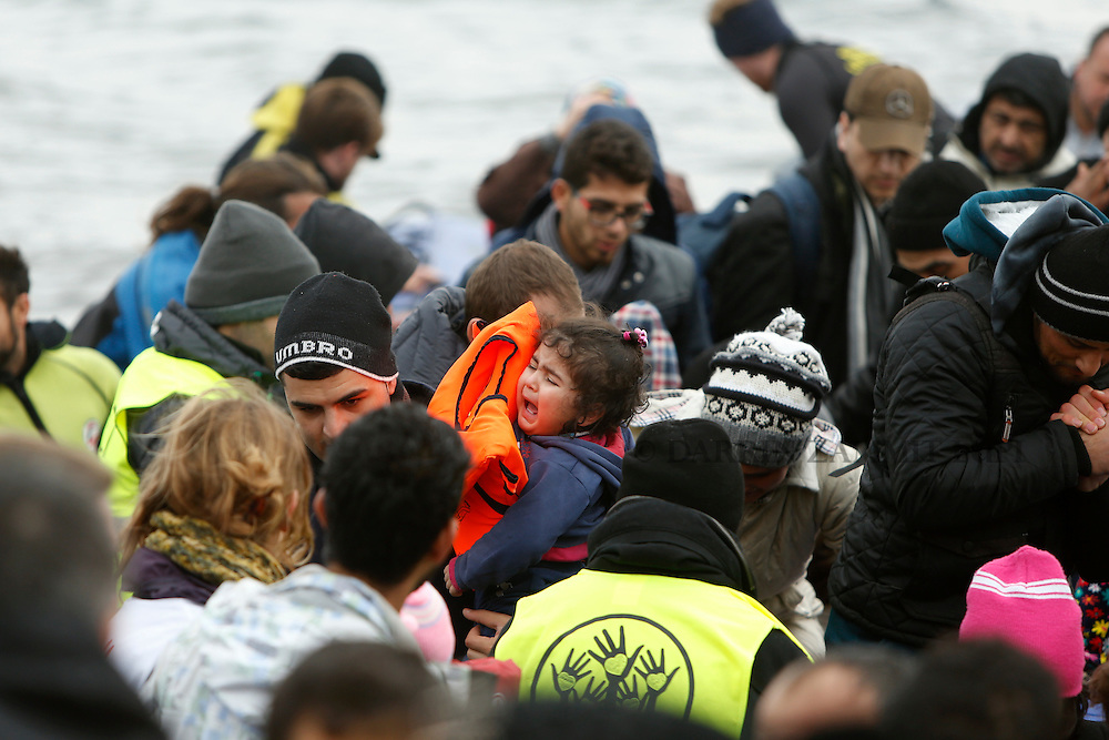 A baby cries as refugees and migrants arrive on a raft on a beach on the the Greek island of Lesbos, January 29, 2016. Photo: Darrin Zammit Lupi