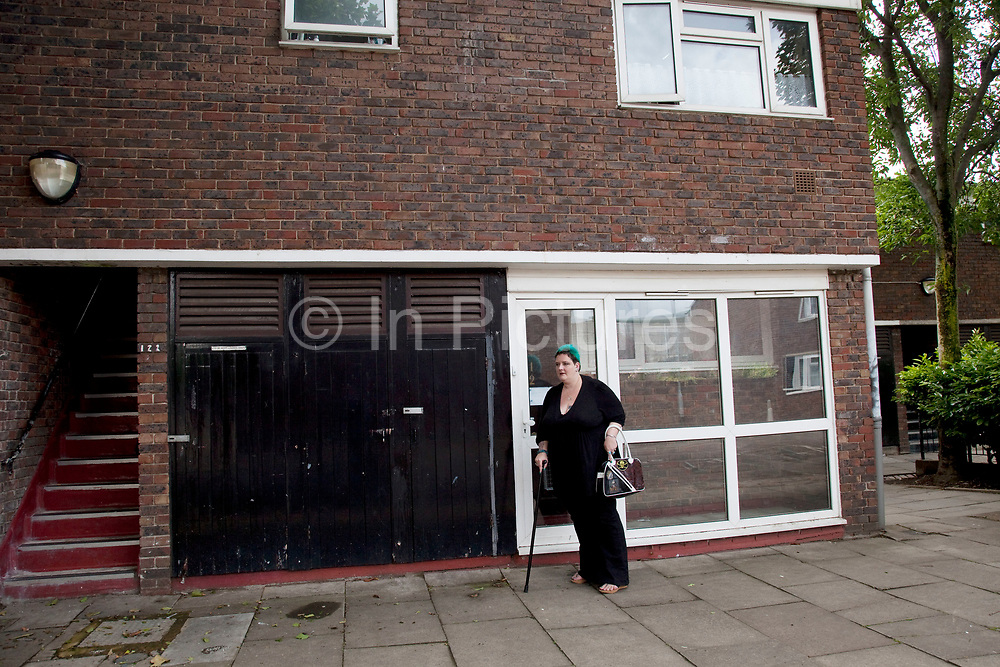 LONDON, ENGLAND, UK, JUNE 18TH 2011. Mother Louise Irwin-Ryan leaving her home to go out in her neighbourhood of Barnsbury, near to Kings Cross, North London. Louise is on various benefits to help support her family income, and housing, although recent government changed to benefits may affect her family drastically, possibly meaning they may have to move out of London. Louise Ryan was born on the Wirral peninsula in 1970.  She moved to London with her family in 1980.  Having lived in both Manchester and Ireland, she now lives permanently in North London with her husband and two children. Through the years Louise has battled to recover from a serious motorcycle accident in 1992 and has recently been diagnosed with Bipolar Affective Disorder. (Photo by Mike Kemp/For The Washington Post)