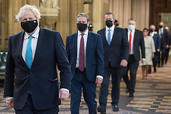 Prime Minister Boris Johnson (left) and Labour leader Sir Keir Starmer (2nd left) walk through the Central Lobby on the way to the House of Lords to listen to the Queen's Speech during the State Opening of Parliament in the House of Lords at the Palace of Westminster in London. Picture date: Tuesday May 11, 2021.