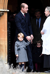 Prince William, Duke of Cambridge and Prince George of Cambridge attend a Christmas Day service at St. Marks Church in Englefield on December 25, 2016.