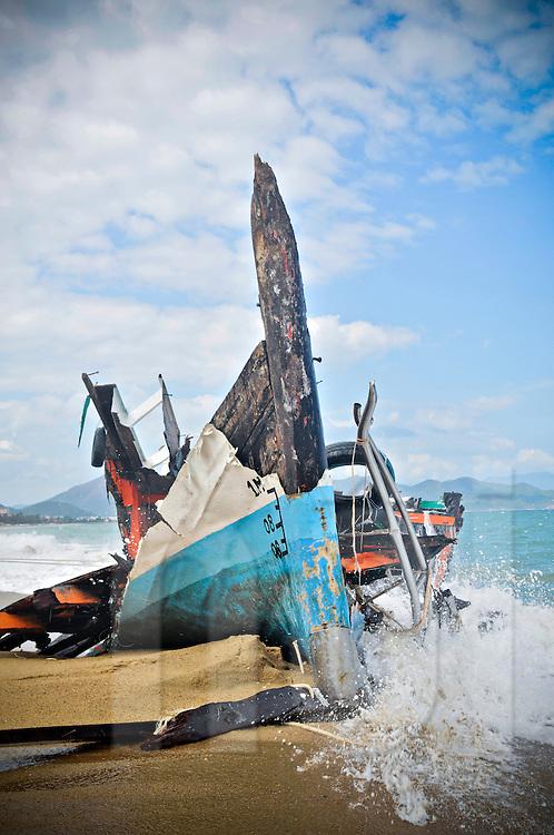 Waves crash over a wrecked ship on Nha Trang beach, Khanh Hoa Province, Vietnam, Southeast Asia