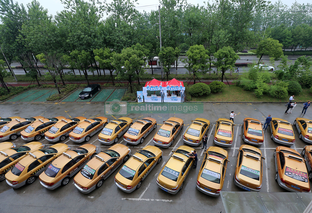 June 6, 2017 - Nantong, Nantong, China - Nantong, CHINA-June 6 2017: (EDITORIAL USE ONLY. CHINA OUT) ..Hundreds of taxis providing voluntary service for students who will attend the upcoming National College Entrance Examination in Nantong, east China's Jiangsu Province. (Credit Image: © SIPA Asia via ZUMA Wire)