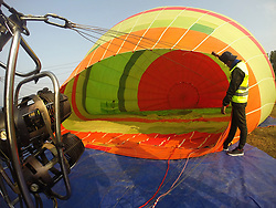 POKHARA, Nov. 17, 2018  A crew member prepares hot air balloon flight during the opening ceremony at Pokhara, Nepal, on Nov. 17, 2018. TO GO WITH Feature: Hot air balloon tour lifting Nepal's tourism. (Credit Image: © Sunil Sharma/Xinhua via ZUMA Wire)