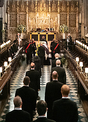 Members of the Royal family, the Princess Royal, the Prince of Wales, the Earl of Wessex, the Duke of York, Peter Phillips, the Duke of Cambridge, the Earl of Snowdon, the Duke of Sussex and Vice Admiral Sir Tim Laurence, follow as the coffin of the Duke of Edinburgh is carried into The Quire during his funeral service at St George's Chapel, Windsor Castle, Berkshire. Picture date: Saturday April 17, 2021.