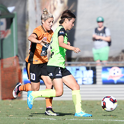 BRISBANE, AUSTRALIA - OCTOBER 30: Yukari Kinga of Canberra United and Katrina Gorry of the Roar compete for the ball during the round 3 Westfield W-League match between the Brisbane Roar and Canberra United at AJ Kelly Field on November 20, 2016 in Brisbane, Australia. (Photo by Patrick Kearney/Brisbane Roar)