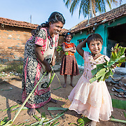 CAPTION: For a long time, Madhushree's mother Bhagya thought that her daughter was a bit of a slow learner, and she had no idea why. Nobody told her that her daughter had autism, and how autistic children could be helped to develop and thrive. During the earliest days following the birth of a child who has (or develops) a disability, parents often struggle to work out what best they can do for him or her, and could use more information and firmer direction. Under the Chamkol programme, such children aged between zero and five and their mothers, expectant mothers and women of child-bearing age will be able to get this through health, wellbeing, development and pre-school programmes run through Early Years' Clubs. LOCATION: Masagapura (village), Kasaba (hobli), Chamrajnagar (district), Karnataka (state), India. INDIVIDUAL(S) PHOTOGRAPHED: From left to right: Bhagya, Megha and Madhushree.