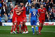 Accrington Stanley midfielder Sam Finley (14), Accrington Stanley defender Michael Ihiekwe (4) and Accrington Stanley defender Callum Johnson (2) celebrate after the final whistle after the EFL Sky Bet League 1 match between Peterborough United and Accrington Stanley at London Road, Peterborough, England on 20 October 2018.