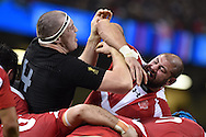 Giorgi Chkhaidze of Georgia ® clashes with Brodie Retallick of New Zealand. Rugby World Cup 2015 pool c match, New Zealand v Georgia at the Millennium Stadium in Cardiff, South Wales  on Friday 2nd October 2015.<br /> pic by  Andrew Orchard, Andrew Orchard sports photography.